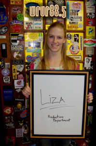 Liza (Productions) in front of the Sticker Door