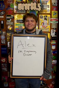 Alex (FM Programming Director, Sting and FM DJ) in front of the Sticker Door