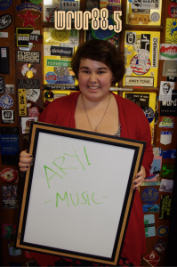 Ary (Music) in front of the Sticker Door