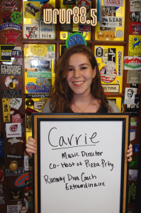 Carrie (Music Director and FM DJ) in front of the Sticker Door