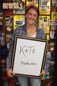 Kate (Productions) in front of the Sticker Door