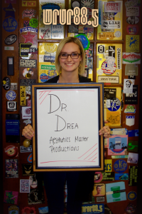 Dr. Drea (Aesthetics Master and Productions) in front of the Sticker Door