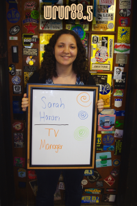 Sarah (WRUR-TV manager) in front of the Sticker Door