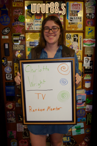 Charlotte (WRUR-TV) in front of the Sticker Door